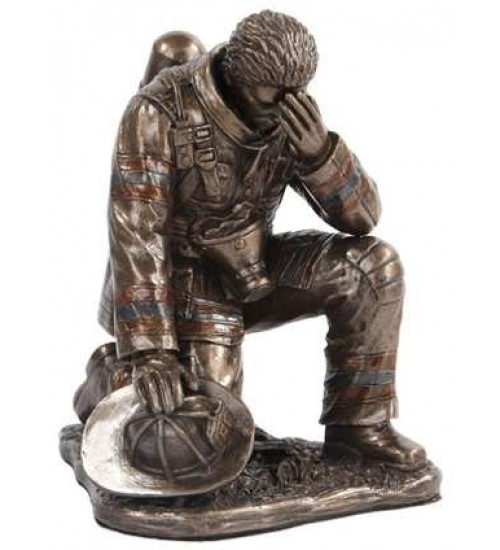A Firemans Reflection Bronze Statue